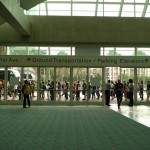 A line forms for attendee badge pick-up.